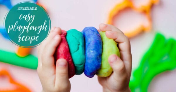 Easy Homemade playdough in child's hands with a text overlay in a circle reading Homemade Easy playdough recipe