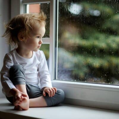 toddler looking out of the window board - see these simple ideas to turn the day around for a happy toddler