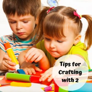 two young children trying to do some crafts at the table with text reading Tips for Crafting with 2