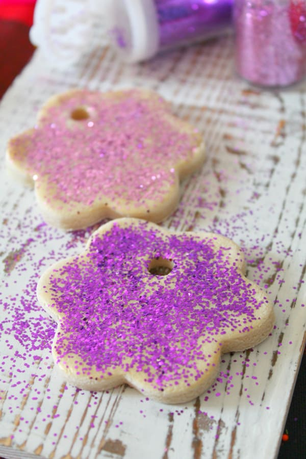 making salt dough decorations with toddler using glitter and glue to decorate