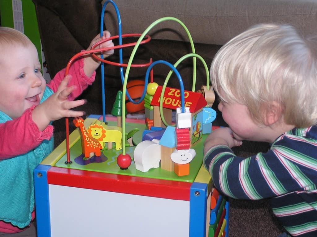 Fine motor toys for babies. A Cube of activities