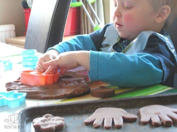 making cookies with homemade chocolate playdough a fun toddler activity