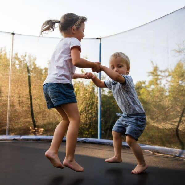 siblings playing together with ideas to nurture and encourage great sibling relationships