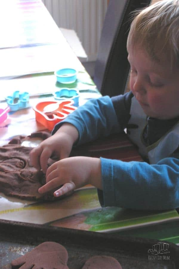 toddler playing making pretend cookies with homemade playdough