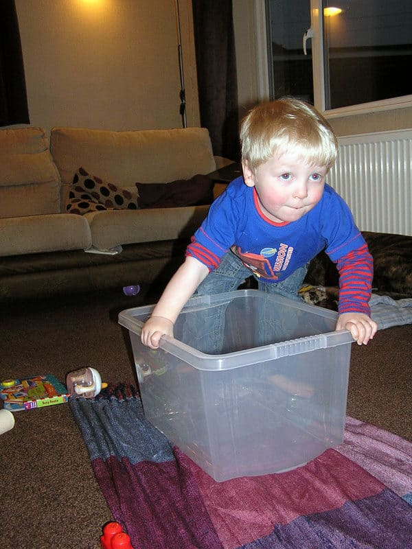 toddler playing pretend boats in a nursery rhyme themed activity for toddlers and babies