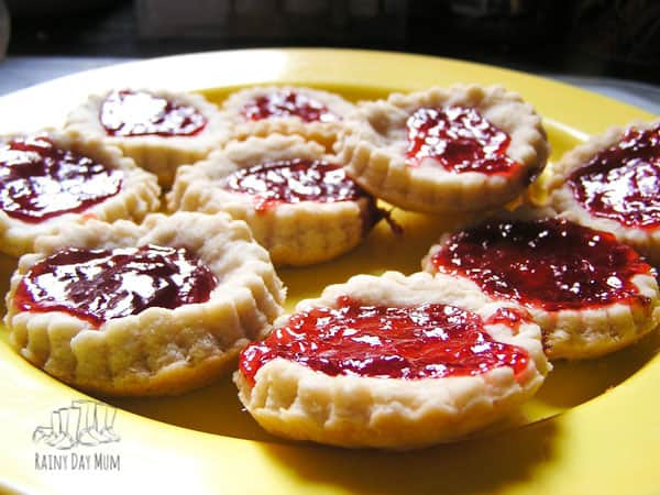 a plate of homemade jam tarts ready for snack time with the kids