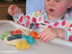 Baby playing with homemade play dough