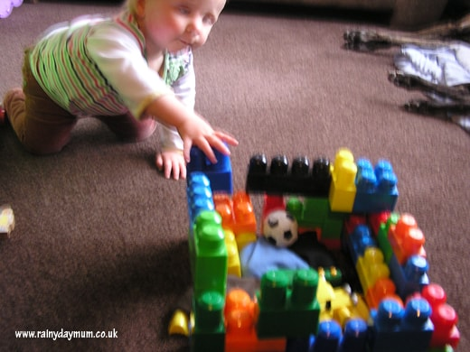 baby destroying toddlers block fort
