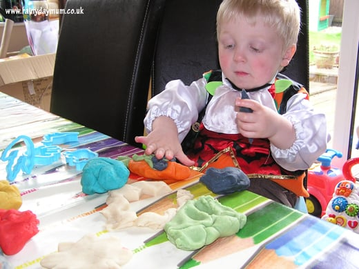 Toddler playing with homemade play dough