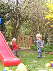 Toddlers playing chase