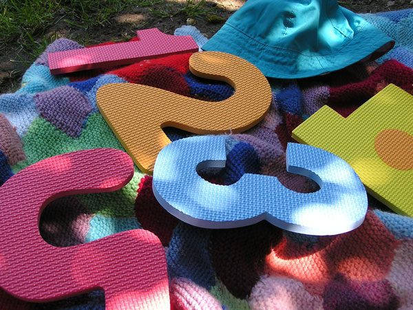 Using foam play mat numbers to create simple hands-on active math activities for toddlers and preschoolers to work on number sense in the early years