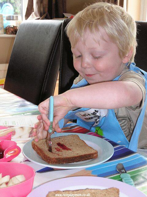 preschooler making sandwiches