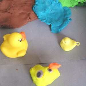 playdough sensory bin themed around five little ducks nursery rhyme for toddlers