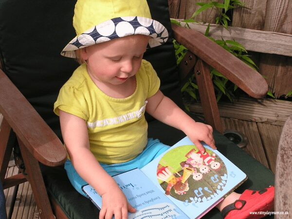 toddler reading in the garden a book from In the Night Garden range of board books
