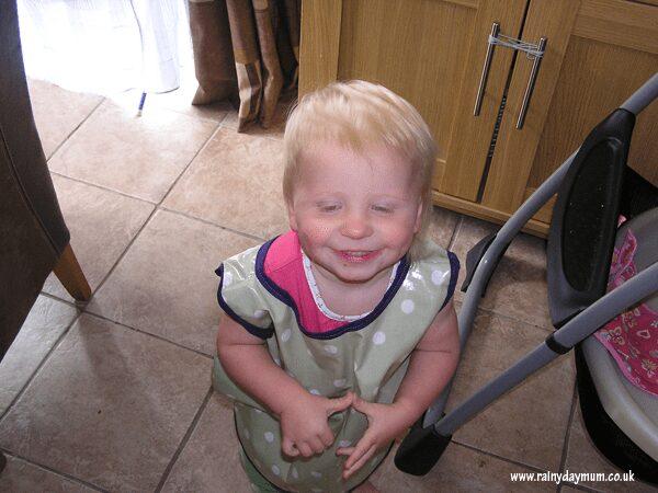 Baby wearing apron