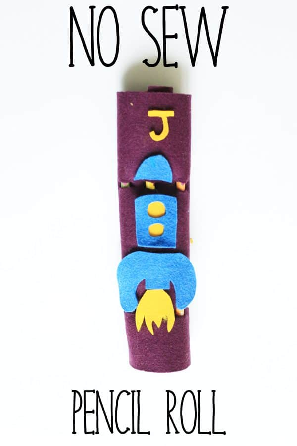An easy to make and decorate with your child no sew pencil roll from felt. This is a great project to make with your child for back to school!