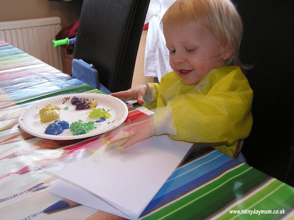 toddler finger painting butterflies