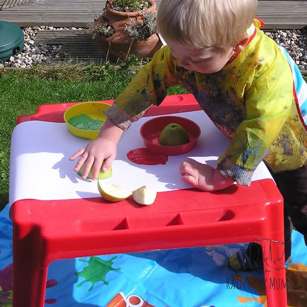 toddler making apple prints