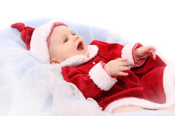 Baby's First Christmas - cute baby girl in Santa Dress ready to celebrate her first Christmas with these classic gift ideas that will last a lifetime