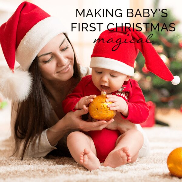 baby and mum with a bauble making baby's first Christmas magical