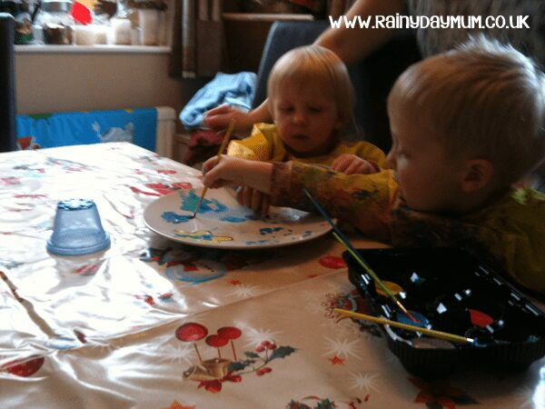 toddler and preschooler painting together