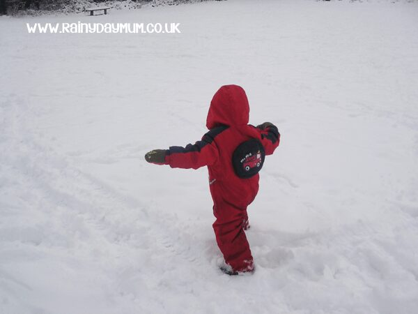 using arms to balance in the snow - gross motor movement development
