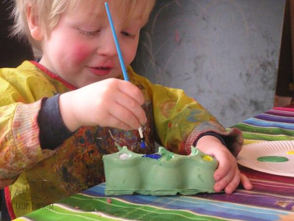 preschoolers painting egg carton caterpillars