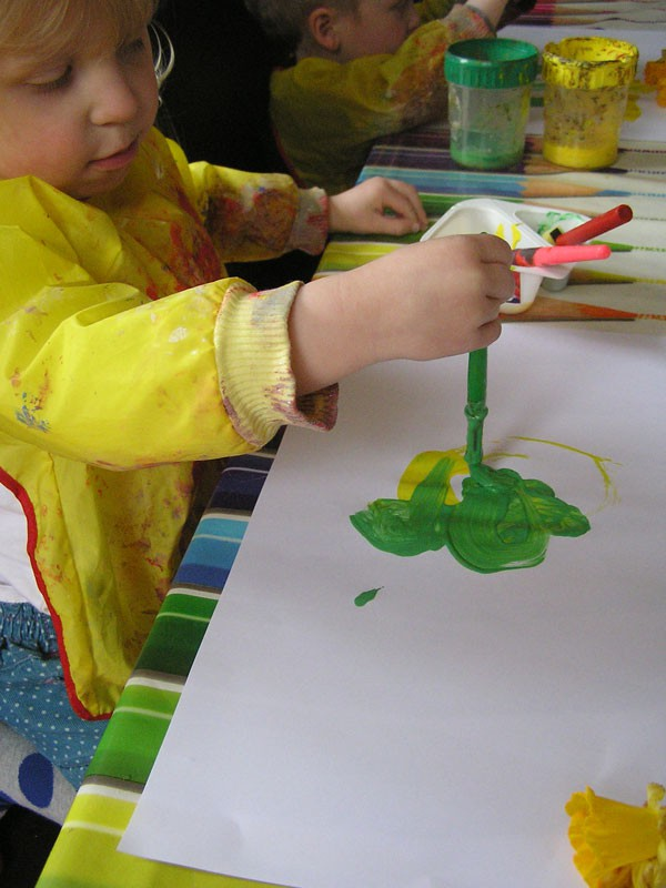 Toddler and preschooler painting together. A separate set of equipment for each to avoid arguments.