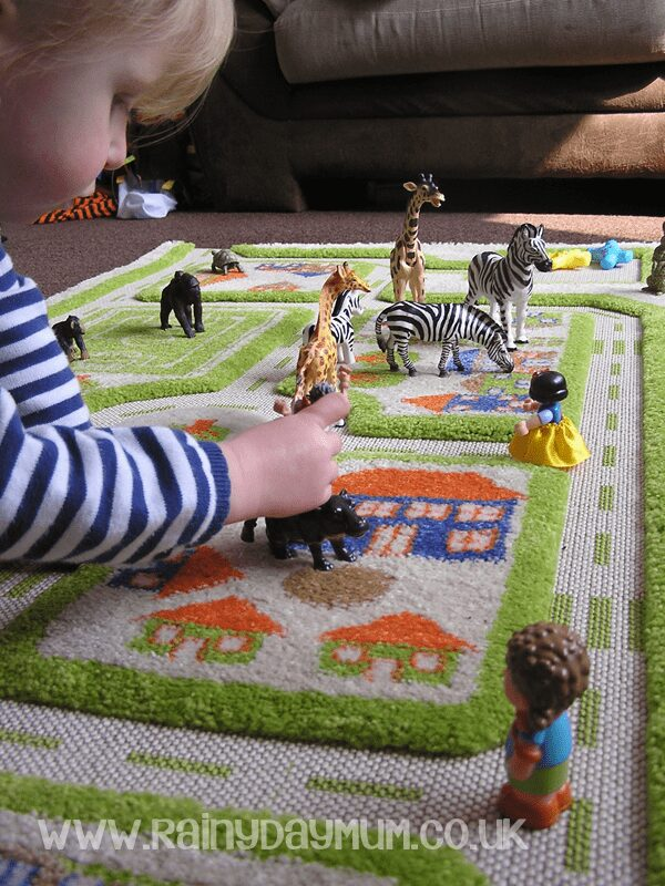 100 days of play - imaginative play for kids - safari on the floor