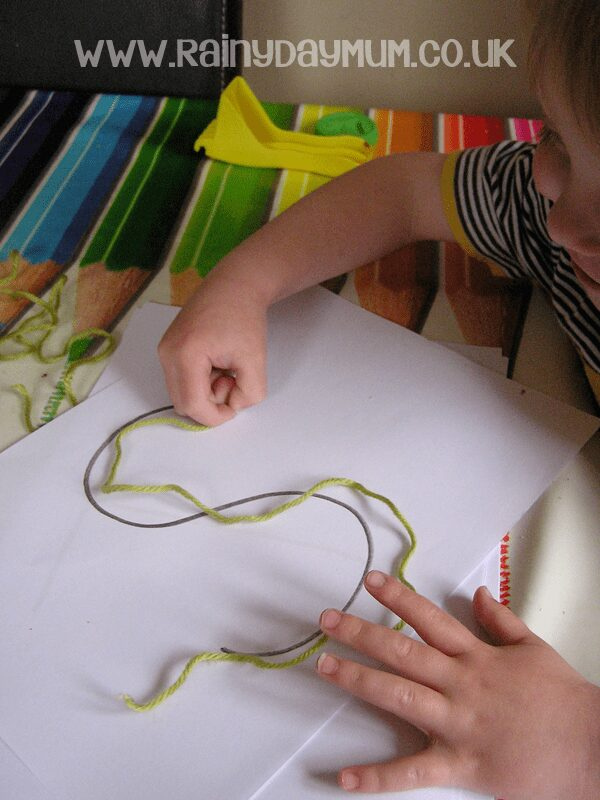 Pre-writing practice for Toddlers and Preschoolers with yarn, shape and letter tracing.