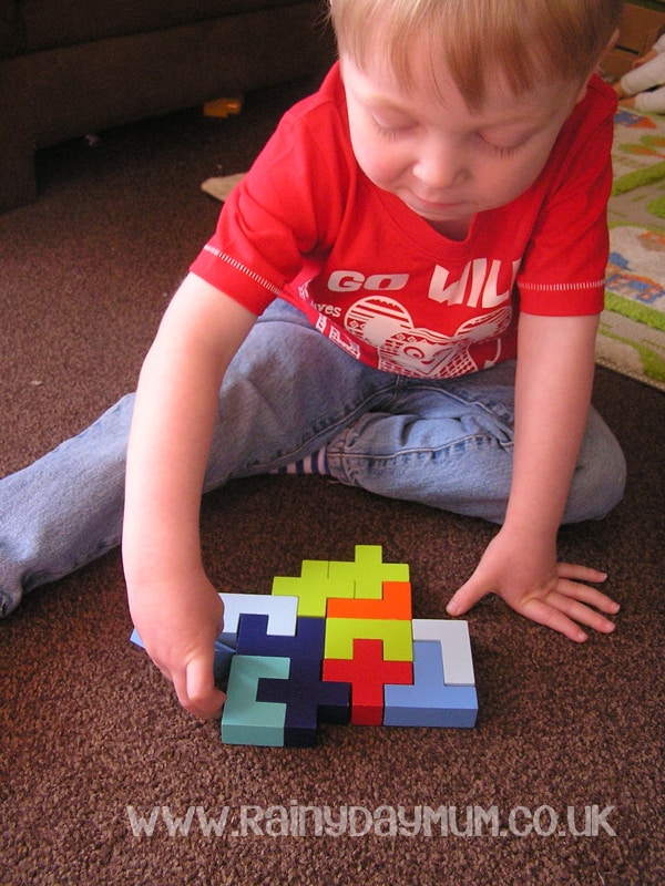 Problem solving with kids, figuring out where the block will go in a real life tetris to complete the pattern