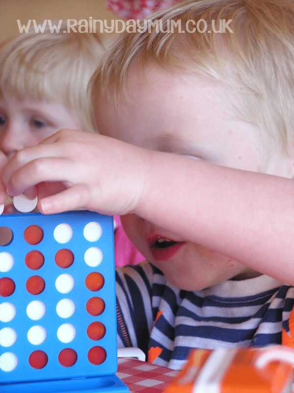toddler playing connect 4