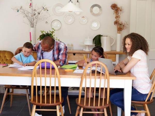 family working at the kitchen table together
