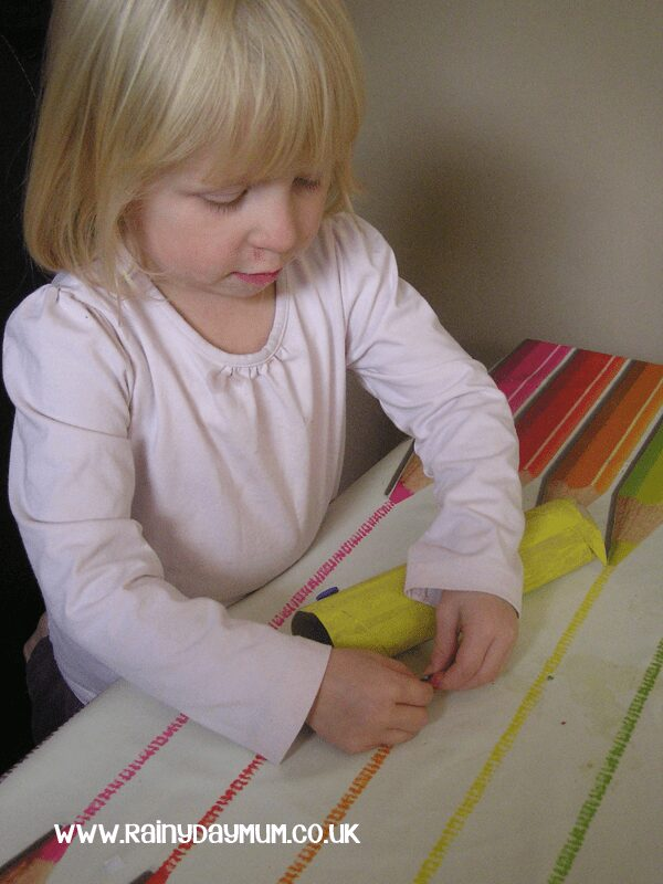 Simple Toddler craft to create a telescope and play I Spy to help learn colours