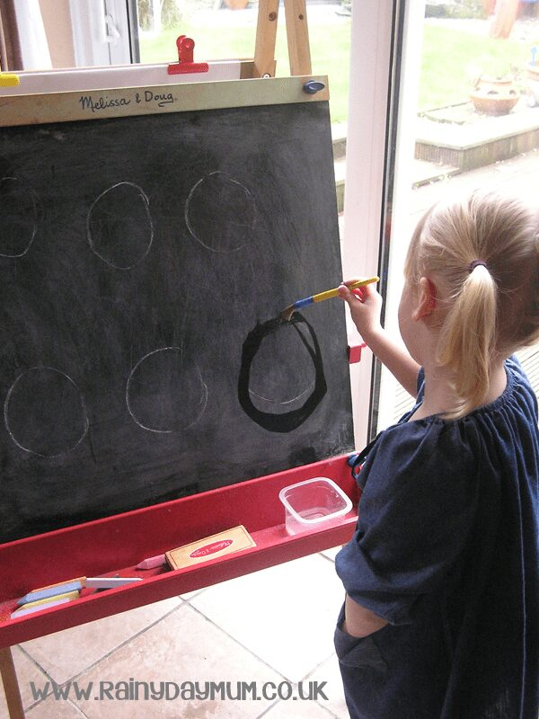 Prewriting skills draw and erase on the chalk board