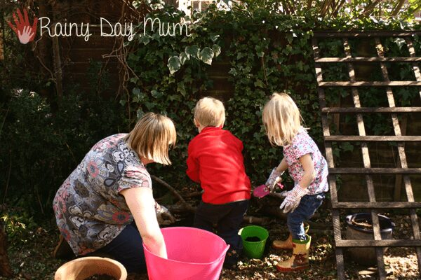 Wildlife gardening with kids building a log pile home