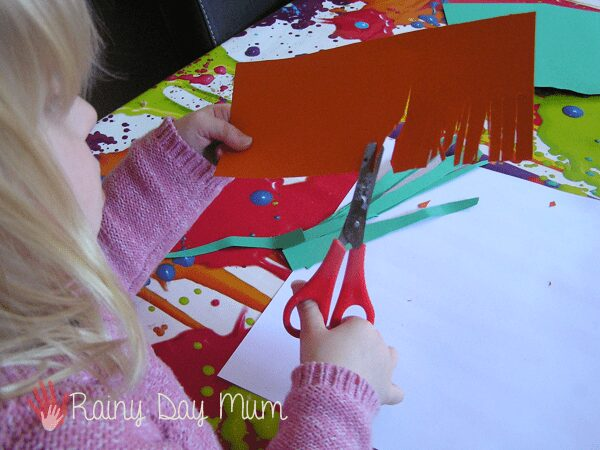 cutting the features of the trumpet of the daffodil for a 3D art collage with preschoolers