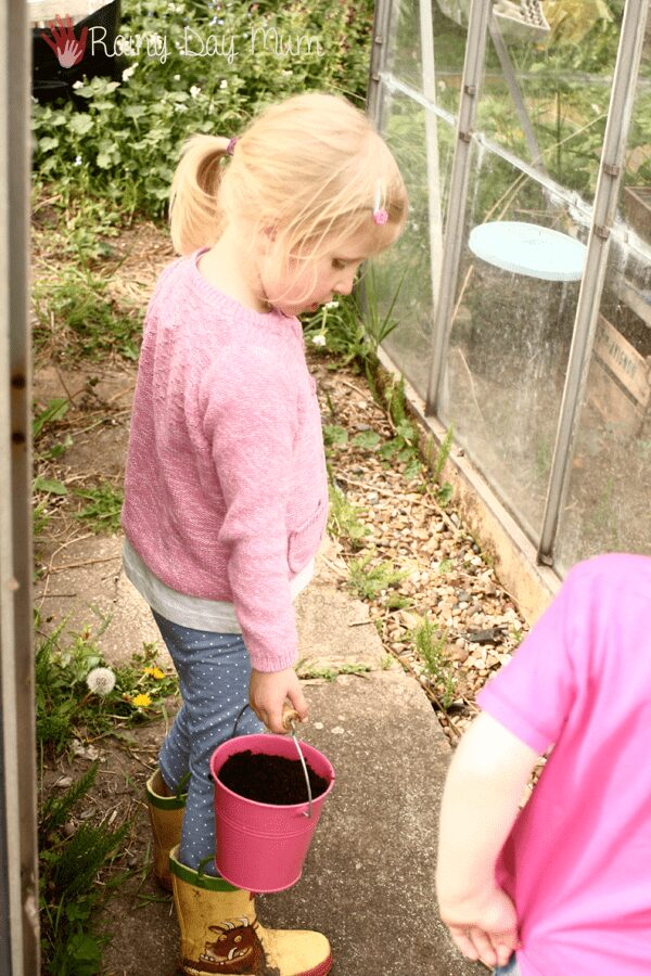 kids collecting soil for a simple indoor gardening project