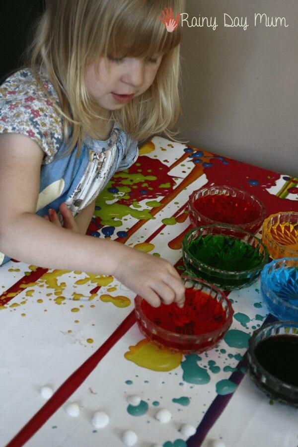 preschooler mixing up dye to create pretty pastel sea shells