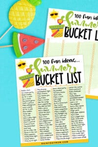 flat lay of the free printable summer bucket list with cute summer fruit puppets on a blue background
