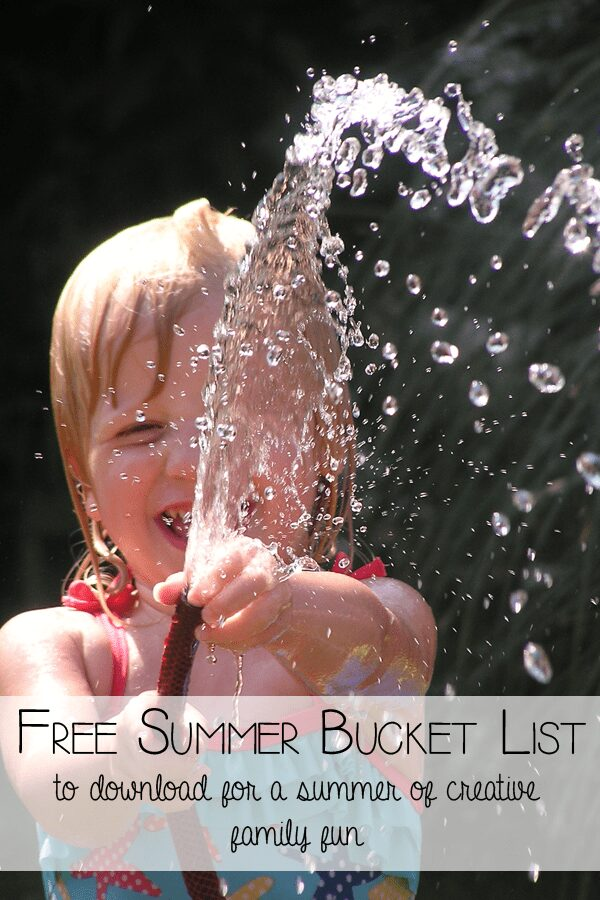 child holding a hose pipe with a text overlay reading FREE Summer Bucket List to download for a summer of creative family fun
