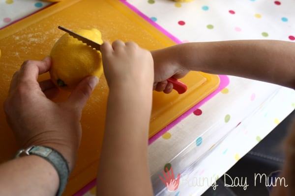 cutting lemons to make simple lemonade for kids