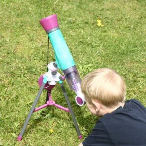 child looking through a kid friendly telescope to observe the craters on the moon during the day