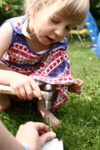 Celebrate Summer with Simple Tin Can Lanterns that Kids Can Make