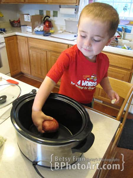 Making Crock Pot Soup with kids to bring alive the book Stone Soup