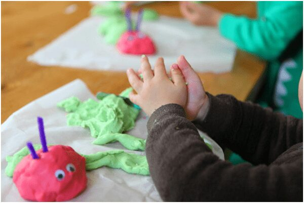 Creating Very Hungry Caterpillar inspired caterpillars with homemade play dough