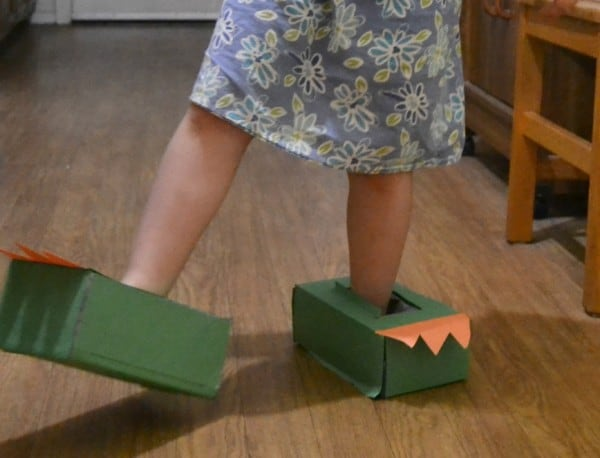Quick and easy dinosaur feet for kids to wear whilst reading Edwina the Dinosaur that didn't know she was extinct