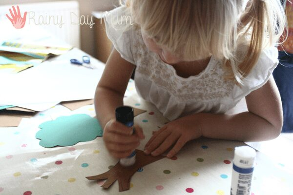 preschooler creating her apple tree