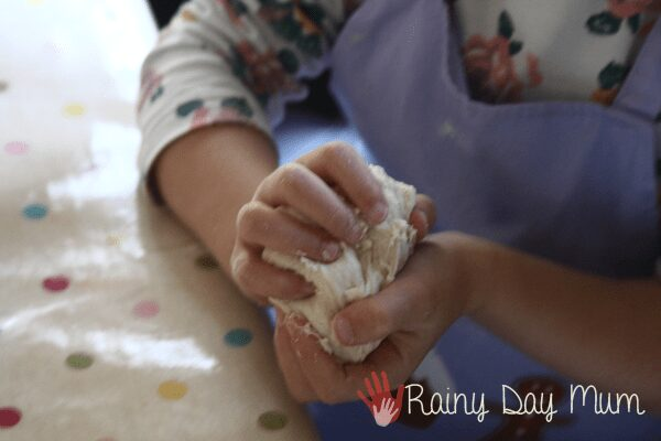 preschool forming bread rolls in her hands