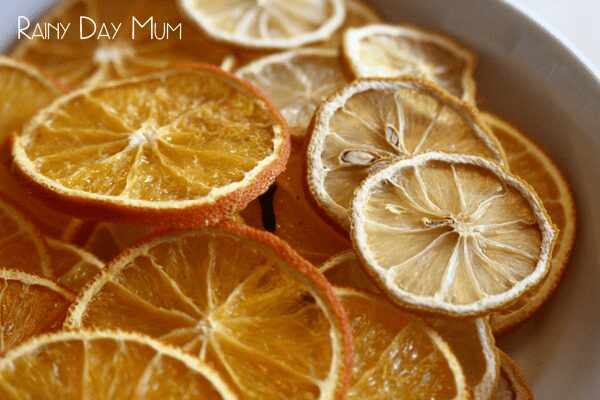 dried orange christmas decorations in a bowl